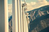stock photo of wind energy  - Wind Turbines and the Mountains - JPG