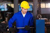 skilled manual worker working in workshop