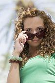 Hispanic teenaged girl wearing sunglasses