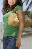Hispanic teenaged girl carrying shoulder bag