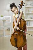 Mixed Race girl holding cello