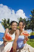 Hispanic women eating watermelon