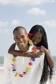 African woman hugging husband