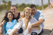 Multi-ethnic couples hugging at beach