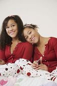 African twin sisters hugging