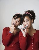 pic of identical twin girls  - African twin sisters brushing teeth - JPG