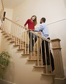 Multi-ethnic couple standing on stairs