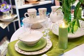 Served fashion green table with glases and plates