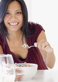 Pacific Islander woman eating cereal