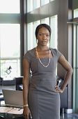 African businesswoman with hand on hip