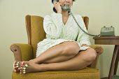 Asian woman talking on telephone