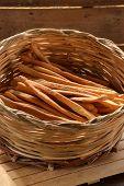 Grissini. fresh breadsticks in a basket on wooden table
