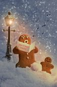 Постер, плакат: Gingerbread men carol singers at Christmas