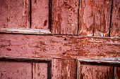 Old Wooden Surface With Cracked Pink Oil-paint