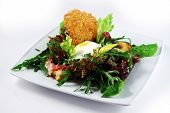 Salad With Poached Egg And Bread Crisp