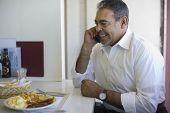 Hispanic man talking on cell phone