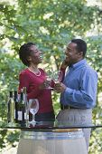 African couple drinking wine