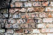 Cracked Brick Wall Stained With Black Tar