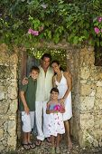Hispanic family in garden doorway