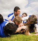 Multi-ethnic male soccer players having fun