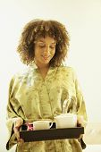 African American woman carrying tea tray