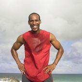 Sweaty African man at beach