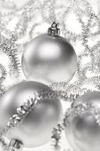 Two silver Christmas baubles