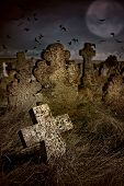 Halloween Terrible Cemetery With Old Gravestones Crosses, The Moon And A Flock Of Crows