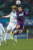 VIENNA, AUSTRIA - DEZEMBER 11 Cristian Ansaldi (#3 Zenit) and Philipp Hosiner (#16 Austria) fight for the ball at a UEFA Champions League game on Dezember 11, 2013 in Vienna, Austria.