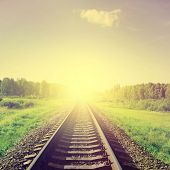 Sunset over railroad in vintage style.
