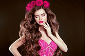 Attractive Girl With Chaplet Of Roses On Head, Long Wavy Hair Styling, Sensual Lips. Fashion Lady Is