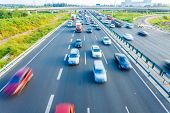 stock photo of smog  - Cars in motion blur on highway - JPG