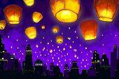 Floating lantern in night sky