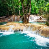 Jungle Landscape With Turquoise Water Of Kuang Si Waterfall. Laos