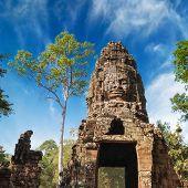 Buddha Face At Ta Prohm Temple Entrance Gate. Angkor Wat Complex, Siem Reap, Cambodia Travel Destina