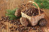 Cedar Nuts In A Wicker Basket On A Wooden Table