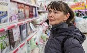 Samara, Russia - October 5, 2014: Young Woman Choosing Bedclothes At Shopping In Supermarket Store M