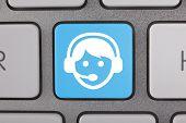 Service on Keyboard White Blue Man