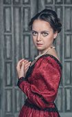 image of pompous  - Portrait of young beautiful medieval woman in red dress - JPG