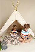 pic of teepee tent  - Child playing at home indoors with a teepee tent - JPG