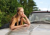 Portrait Of Pretty Girl And Car