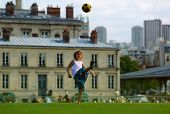 Girl Playing Football In Front The School Building In The First School Day