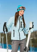 Half-length portrait of female alpine skier. Concept of winter sports and cute entertainment