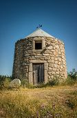 Vertical image of an old typical Portuguese windmill