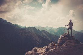 foto of mountain-high  - Woman hiker on a top of a mountain  - JPG