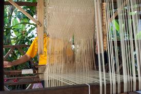 foto of handloom  - Woman weaving silk in traditional way at manual loom - JPG