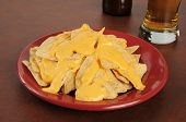 Tortilla Chips With Cheese Sauce And Beer