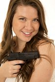 picture of pistols  - Woman with black pistol close up smiling - JPG