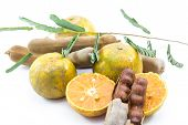 stock photo of tamarind  - fresh orange and tamarind with leaf Thai fruits - JPG