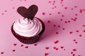 Delicious Valentine Day cupcake on pink background